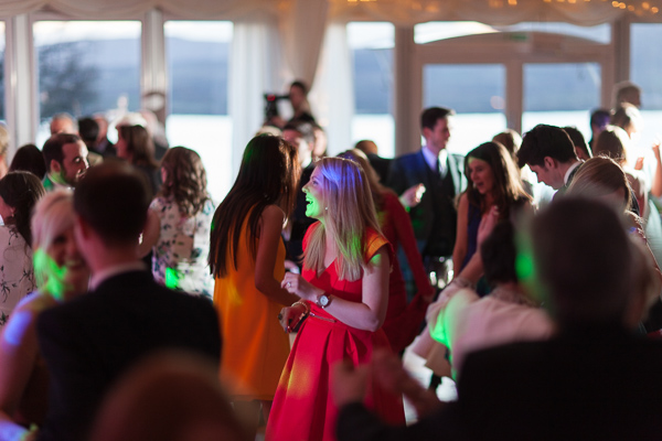 guests dancing with disco lights