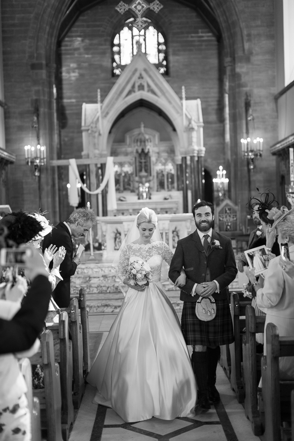 newlyweds walking down the aisle fotogenic of scotland