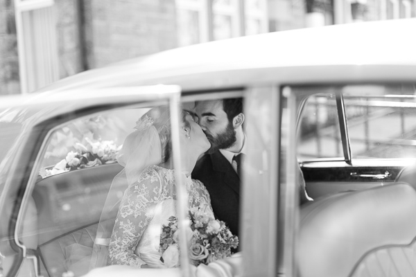newlyweds in the car kissing