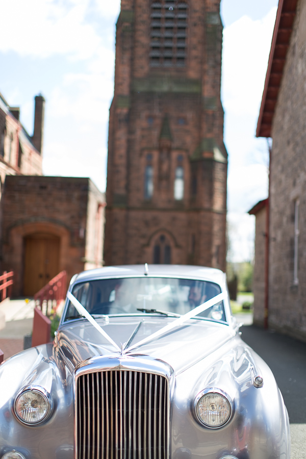 wedding car leaving the church