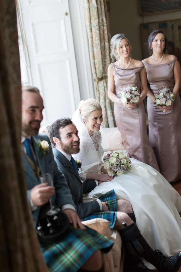 bridal party laughing at boturich castle wedding