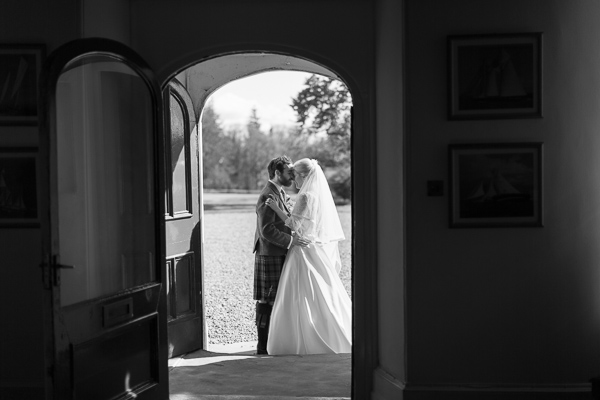 bride and groom kissing at Boturich Castle Wedding