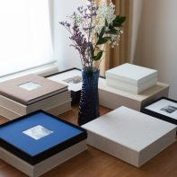 wedding albums photos on a table with flowers from glasgow scotland photographer