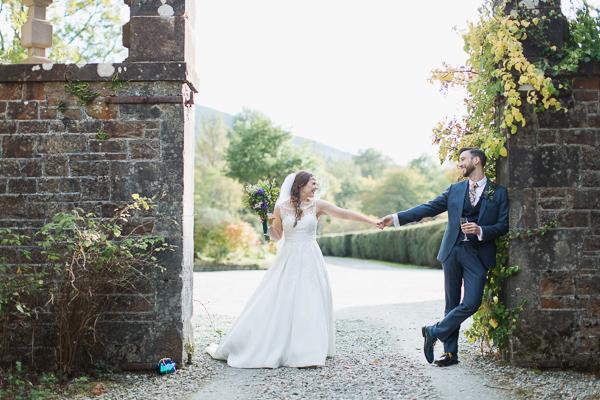 bride and groom holding hands wedding photos glasgow