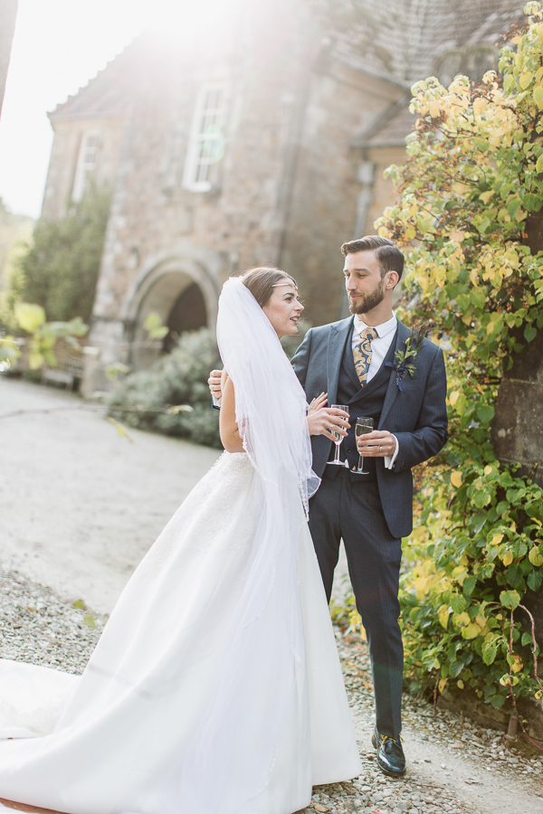 married couple drinking champagne at wedding venue in scotland
