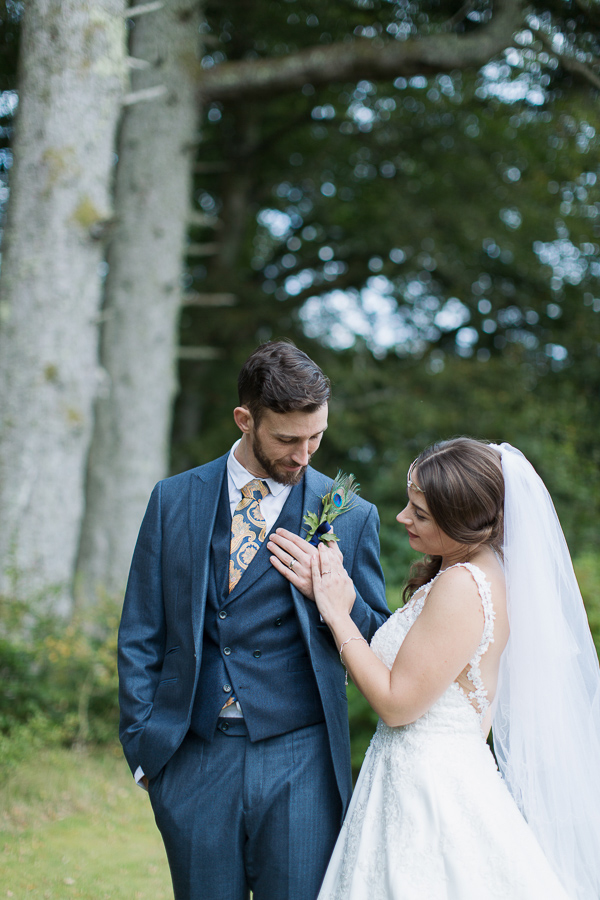 bride and groom looking at their weddings rings