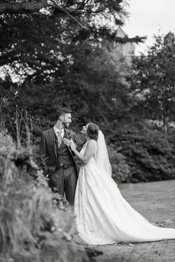 wedding photos of newlyweds looking at each other in ardkinglas garden