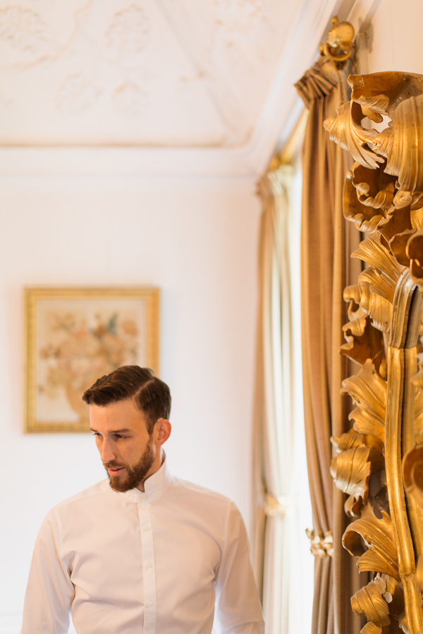 portrait of groom in white shirt