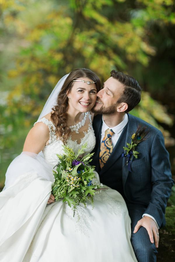 wedding photographers bride and groom happy kissing