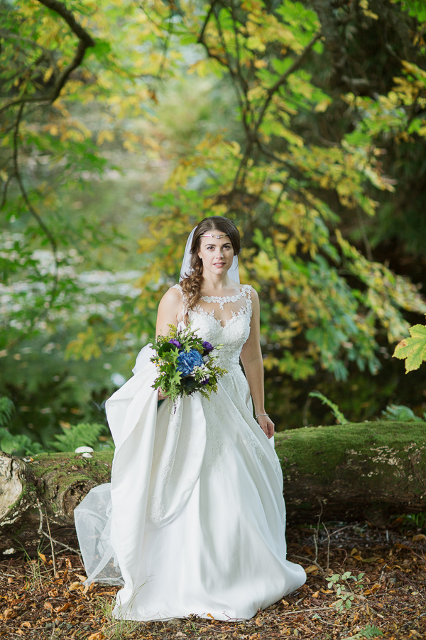 bride standing in a forest scotland