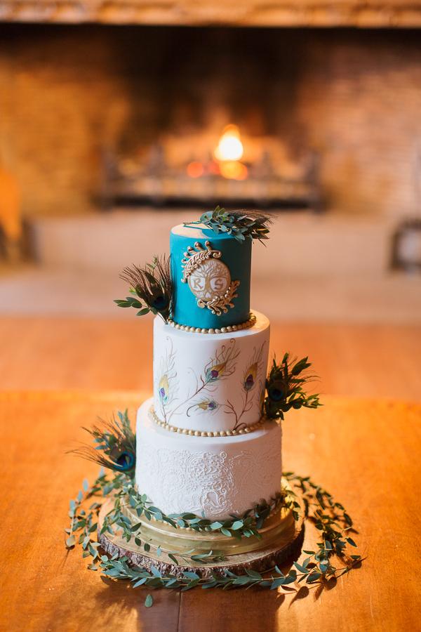 impressive wedding cake at main hall in scottish wedding venue ardkinglas