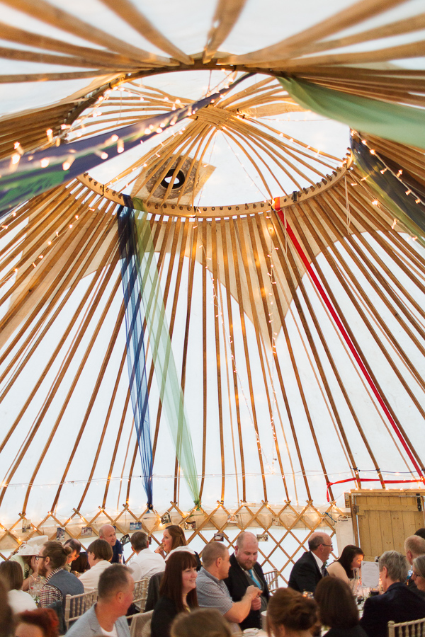 interior of tipi tent with wedding guests