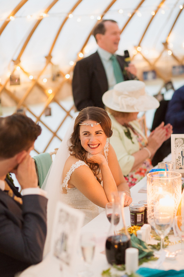 bride smiling to groom during father