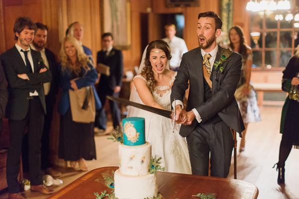 newlyweds cutting cake at scottish castle wedding venue