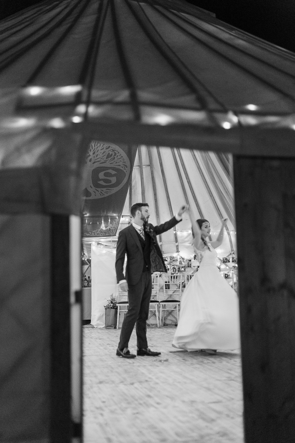 bride and groom practising before the furst dance at tipi tent
