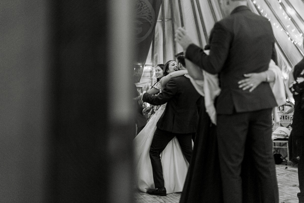 bride and groom embraced during dance