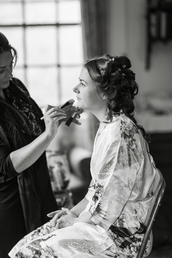 laura grey make-up artist with bride during preparations at ardkinglas