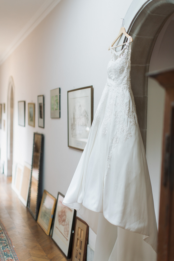 wedding dress hanging in a hall at ardkinglas