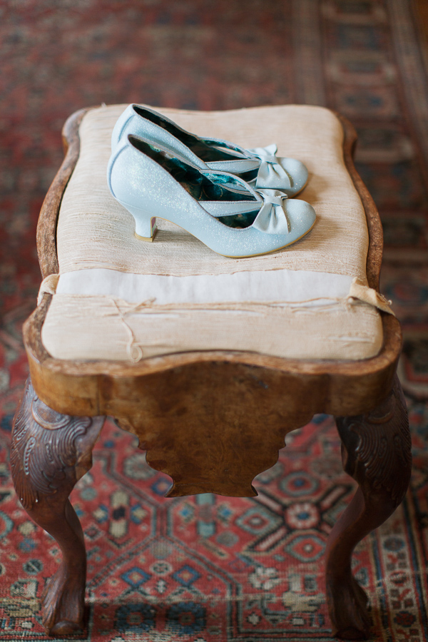 blue weddign shoes on a vintage stool
