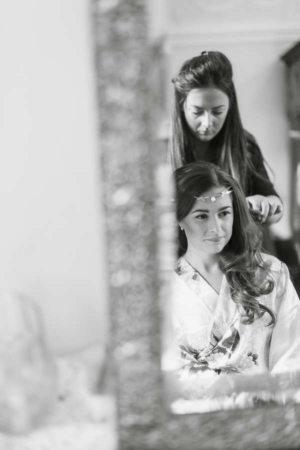 bride having her hair done at ardkinglas wedding venue near glasgow in scotland