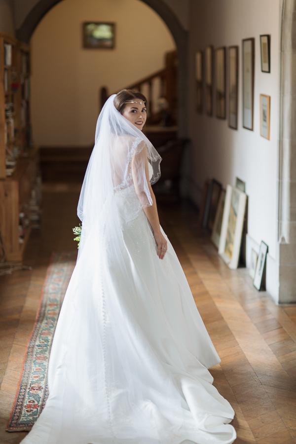 bride waling down corridor at ardkinglas wedding venue