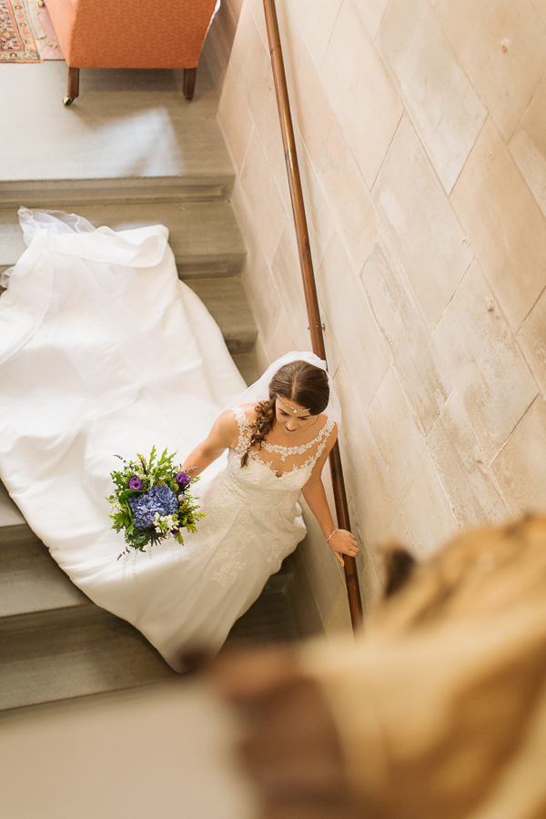 bride walking down the stairs leaving for ceremony