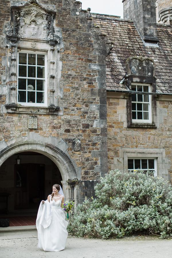 bride at the main entrance to ardkinglas