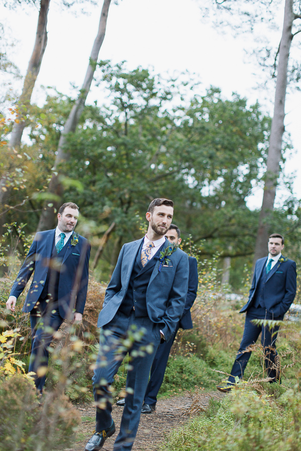 groom with groomsmen walking down to ceremony