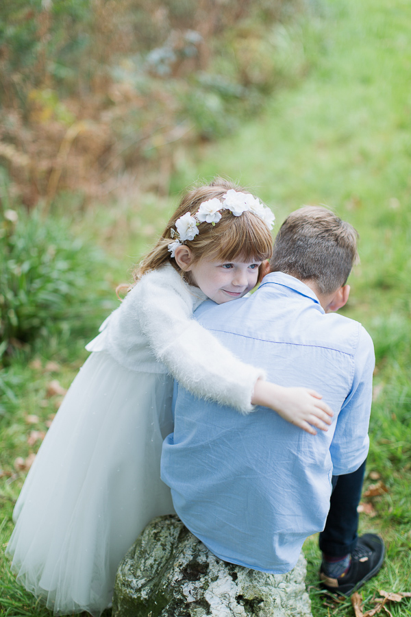 flower girl huging his brother before ceremony