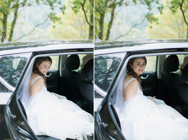 bride going out of car at outdoor ceremony