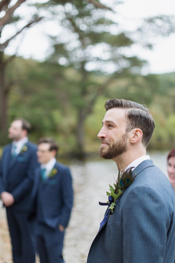 groom emotional seeing bride walking down outdoors