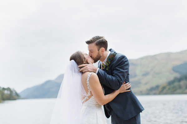 bride and groom kissing during ceremony scotland