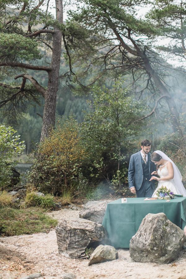 bride and groom looking at their wedding rings