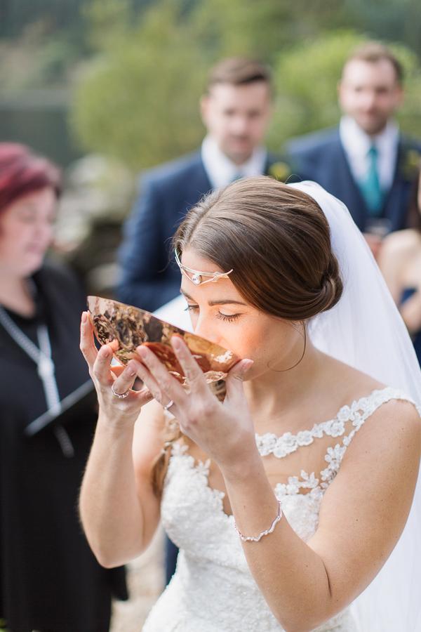 bride drinking from quechee wedding ceremony