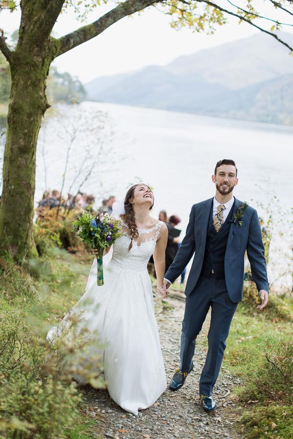 bride and groom just married walking