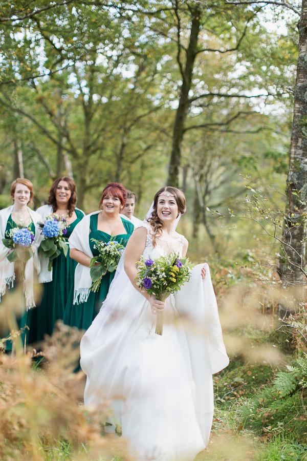 bride with bridesmates smiling
