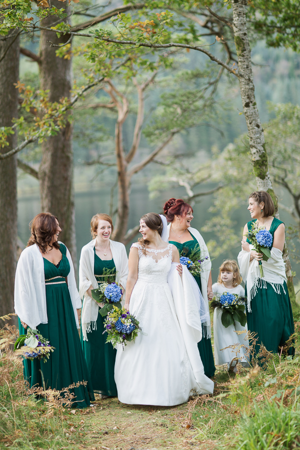 bride with bridesmates and flowergirl
