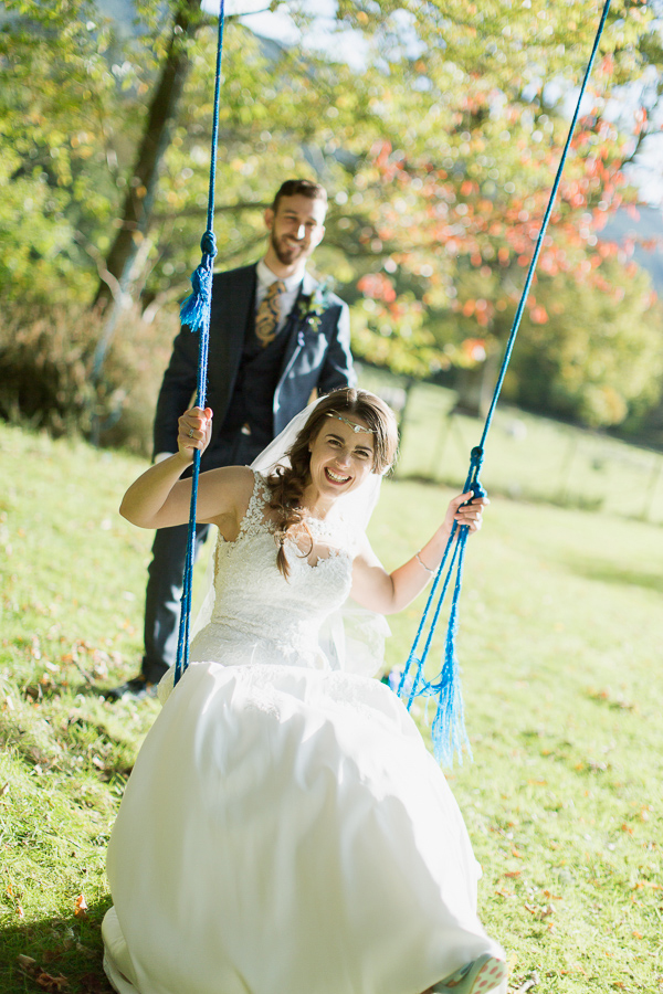 weddign photographer glasgow bride laughing on a swing
