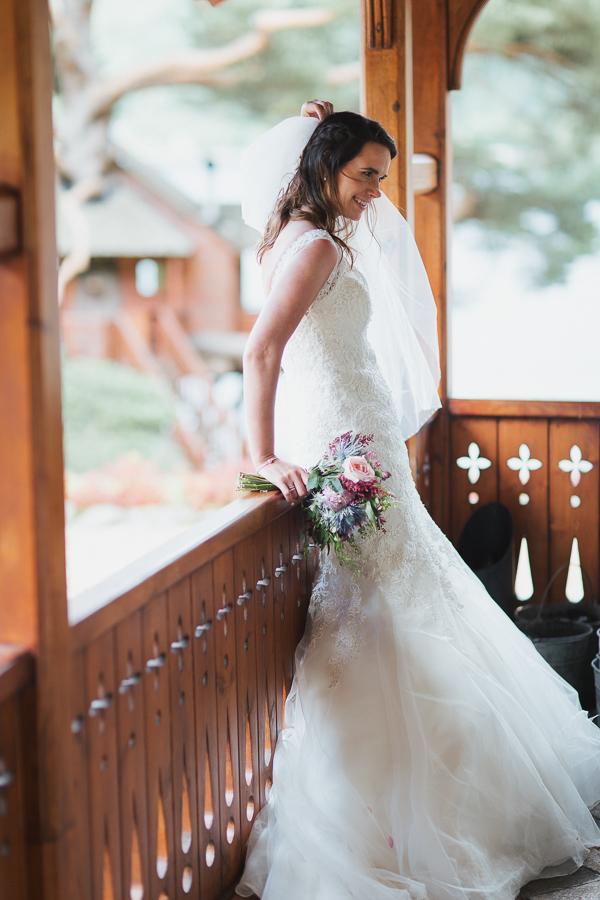 bride smiling fixing her veil loch goil wedding