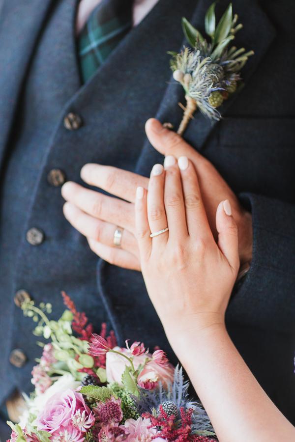 hands with weddings rings