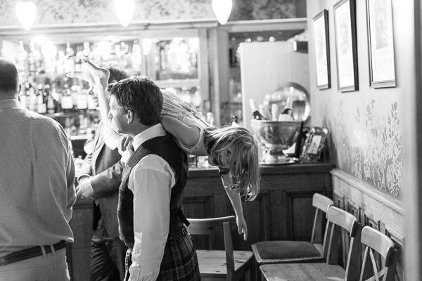 dad lifting his daughter