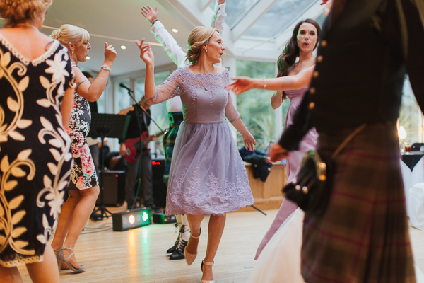 guests and bridesmates dancing
