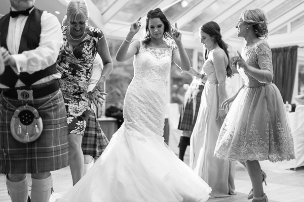 bride dancing with guests at the lodge on loch goil