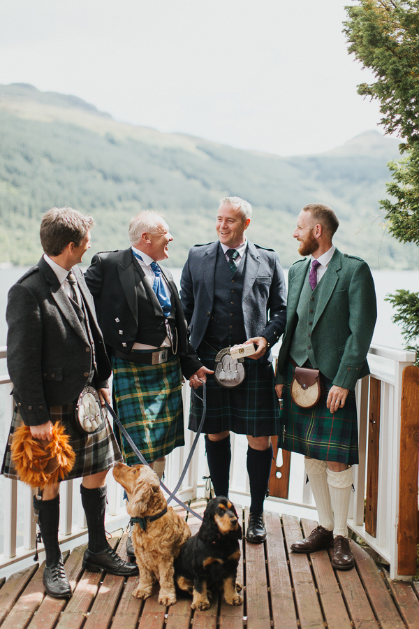 groom with groomsmen and dogs