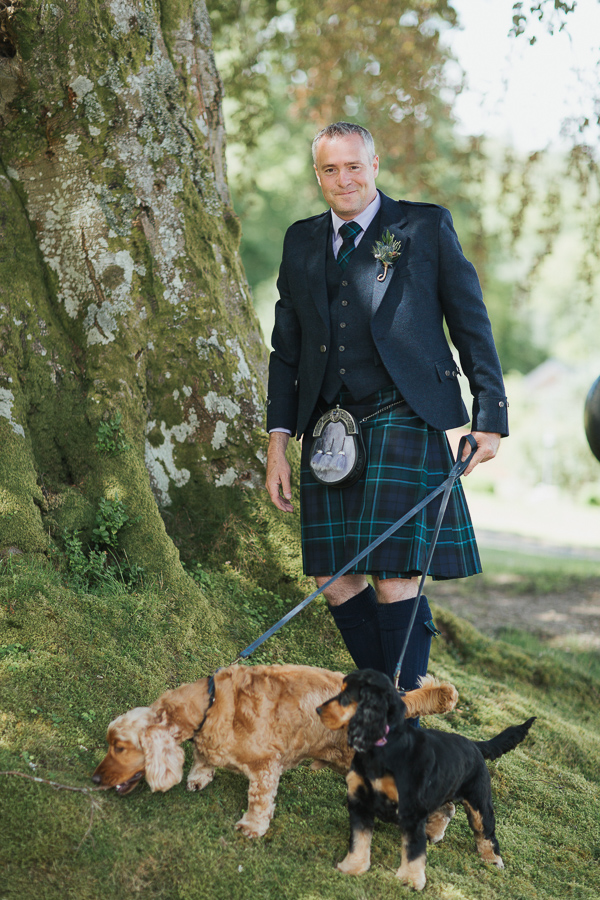 groom with dogs before wedding ceremony in a dog firnedly scottish venue