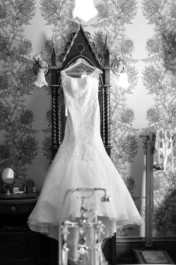 wedding dress hanging on a vintage victorian mirror at the lodge on loch goil