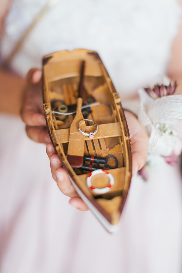 engagement ring on a mdel of a boat