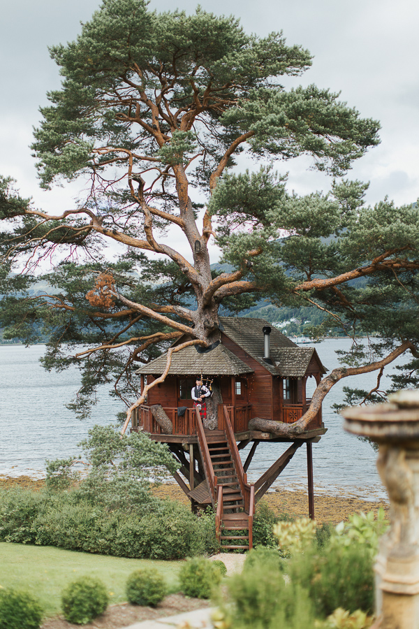 tree house at the lodge on loch goil scottish wedding venue with piper