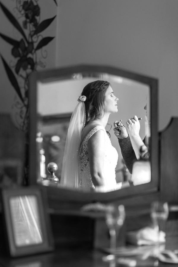 bride having her makeup done final touches