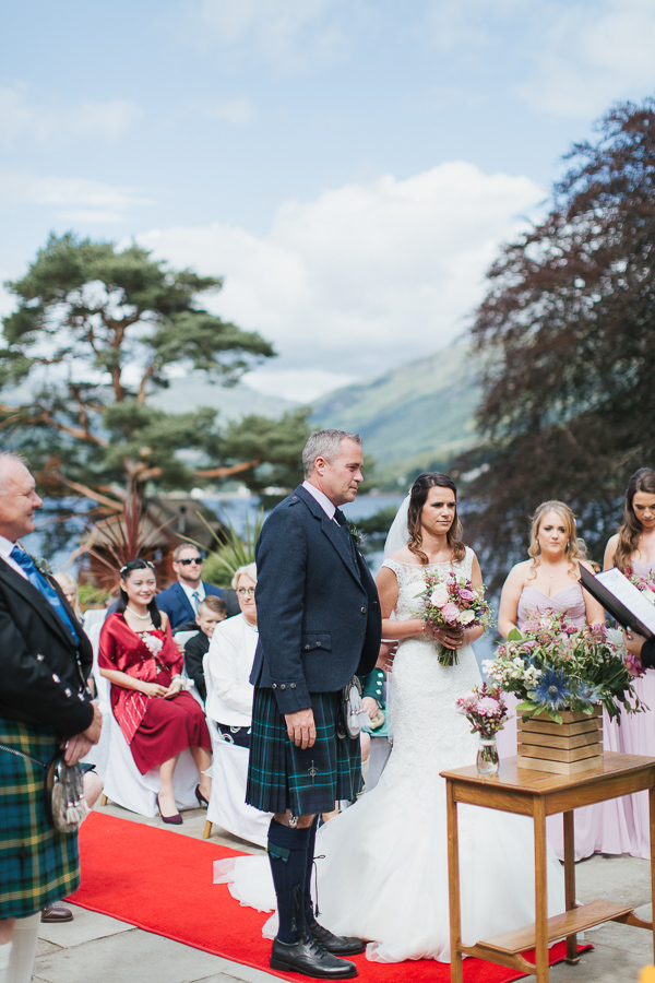 outdoors wedding ceremony at the lodge on loch goil